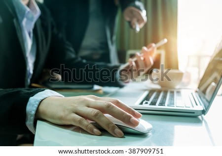 businesswoman hand working with modern technology and digital layer effect as business strategy concept in morning light  - stock photo