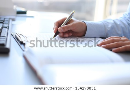 Businesswoman hands pointing at business document - stock photo