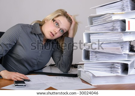Businesswoman has stress because of huge work on her desk