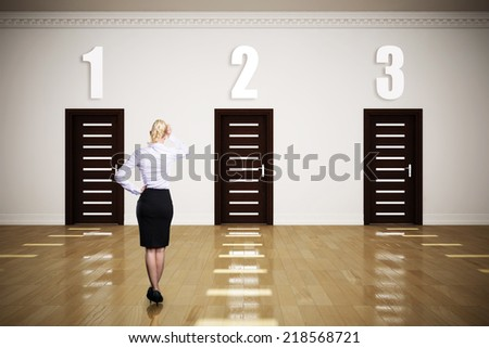 businesswoman has to choose between 3 options  - stock photo