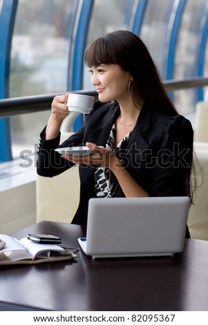Businesswoman having a cup of tea - stock photo