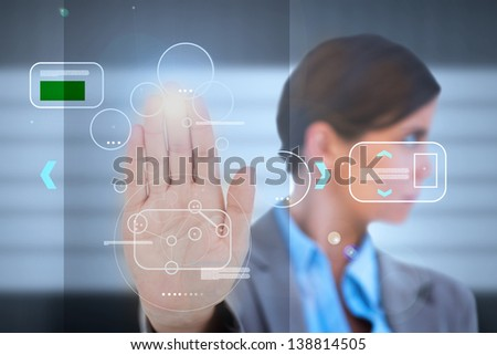 Businesswoman having a palm print identification for a security entrance - stock photo
