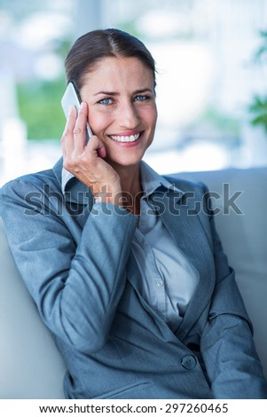 Businesswoman having a phone call in office