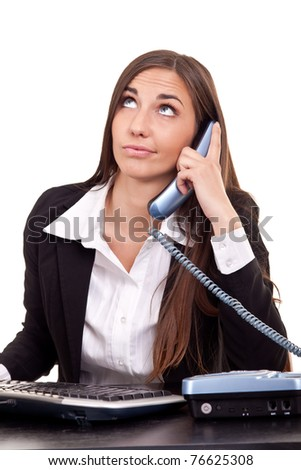 businesswoman having  boring call in office - stock photo