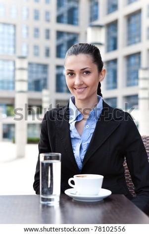 businesswoman having break,  outdoor drinking coffee - stock photo