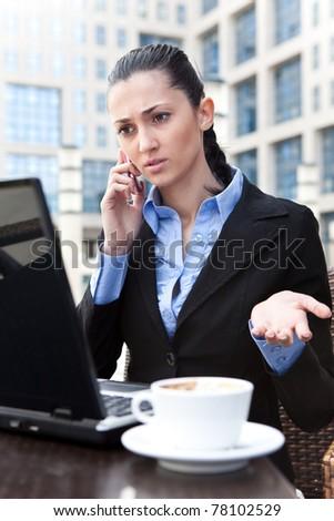 businesswoman having discussing on phone, irritation face - stock photo