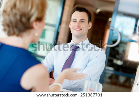Businesswoman having discussion with collegues