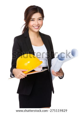 Businesswoman hold with clipboard, hard hat - stock photo