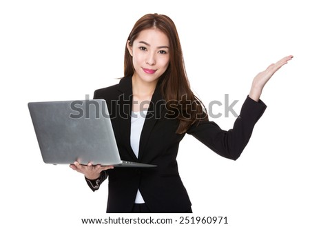 Businesswoman hold with laptop and open hand palm - stock photo
