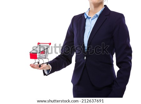Businesswoman hold with small shopping cart - stock photo