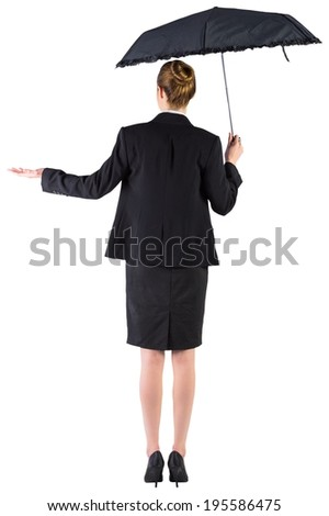Businesswoman holding a black umbrella on white background