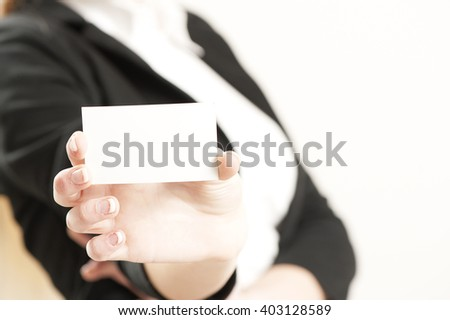 Businesswoman holding a blank business card. Selective focus on blank business card - stock photo