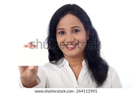 Businesswoman holding a blank card against white background    - stock photo