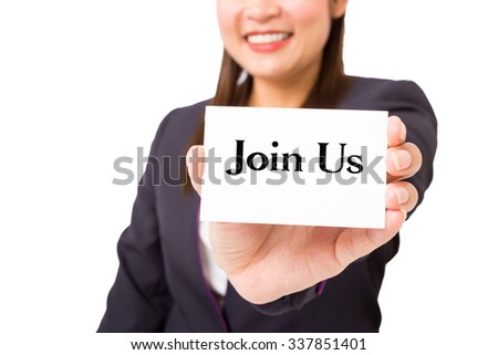 "Businesswoman holding a card with the word ""Join us"". - stock photo"