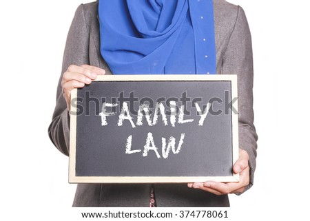 Businesswoman holding a chalk board written Family Law - stock photo