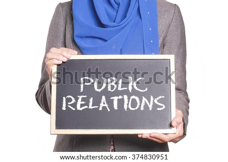 Businesswoman holding a chalk board written Public Relations - stock photo