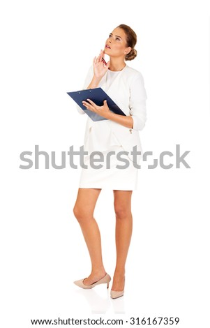 Businesswoman holding a clipboard and thinking about something.