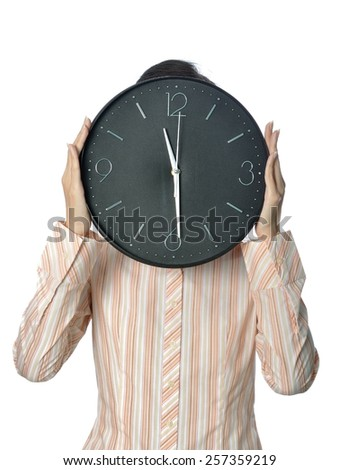 Businesswoman holding a clock in front of her face isolated on white background - stock photo