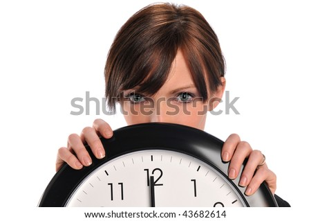 Businesswoman holding a clock isolated on a white background - stock photo