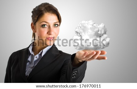 Businesswoman holding a cloud in the hand, cloud computing concept