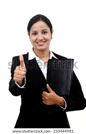 Businesswoman holding a document file and showing thumb up - stock photo