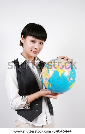 businesswoman holding a globe on white background