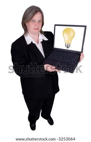 Businesswoman holding a laptop with a lightbulb isolated over white with a clipping path - stock photo