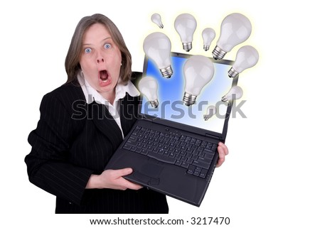 Businesswoman holding a laptop with light-bulbs flying out with a shocked expression isolated over white - stock photo