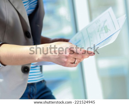 businesswoman holding a paper. - stock photo