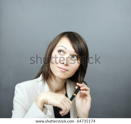 Businesswoman holding a pen - stock photo