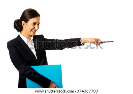 Businesswoman holding a pen and binder