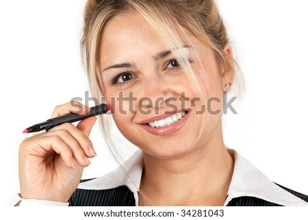 Businesswoman holding a pen and face turned to viewer.