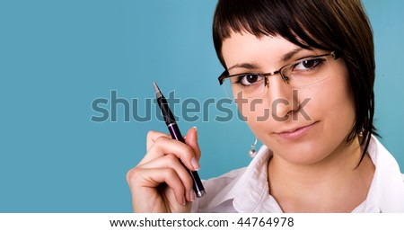Businesswoman holding a pen and thinking. - stock photo