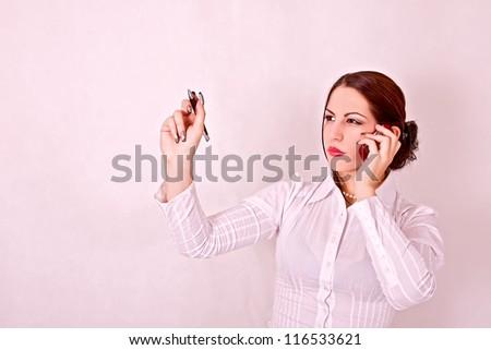 Businesswoman holding a pen to write a diagram - stock photo