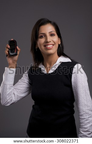 Businesswoman holding a phone - stock photo