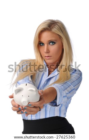 Businesswoman holding a piggy bank against a white background