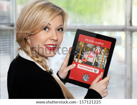 businesswoman holding a tablet with mobile wallet onlain shopping on the screen - stock photo