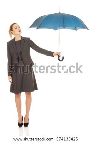Businesswoman holding an umbrella. - stock photo