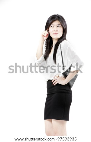 businesswoman holding bag and posing