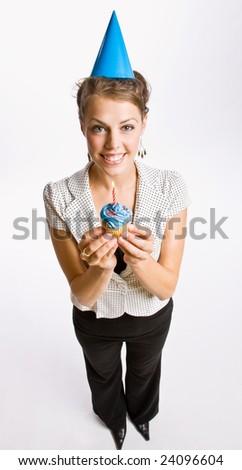 Businesswoman holding birthday cupcake - stock photo