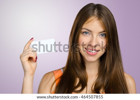 Businesswoman holding blank businesscard