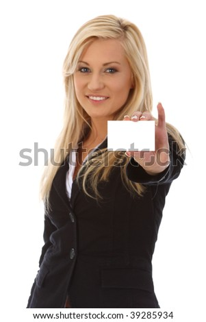 Businesswoman holding blank card - stock photo