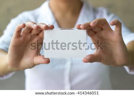 Businesswoman holding blank card  - stock photo