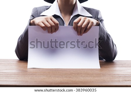 Businesswoman holding blank paper at the desk. - stock photo