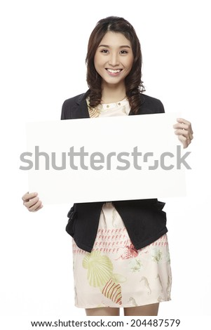 Businesswoman holding blank whiteboard sign. Casual business woman in suit is holding blank billboard placard and showing its empty copy-space. On white. - stock photo
