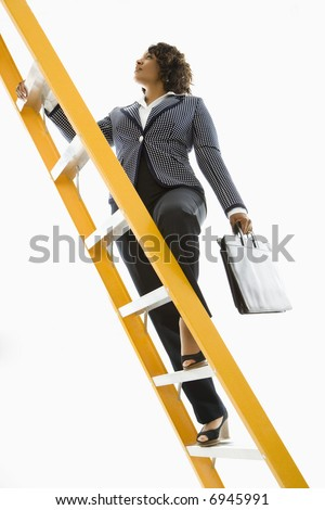 Businesswoman holding briefcase climbing ladder. - stock photo