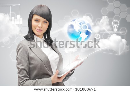 Businesswoman holding business world using tablet computer - stock photo