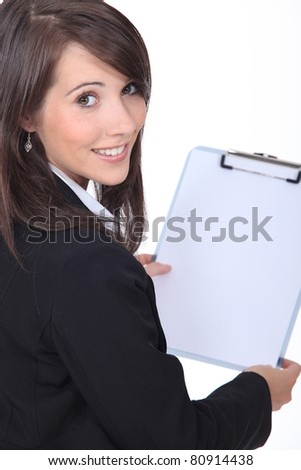 Businesswoman holding clipboard - stock photo