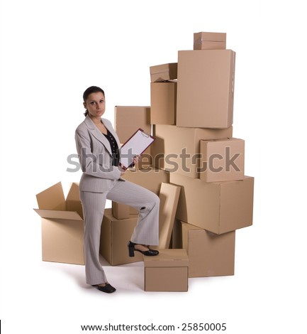 businesswoman holding clipboard, standing one leg on the cardboard box, carton  box in background - stock photo