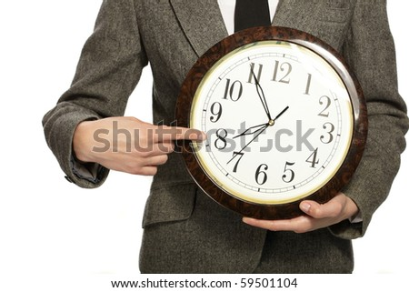 Businesswoman holding clock in hands - stock photo